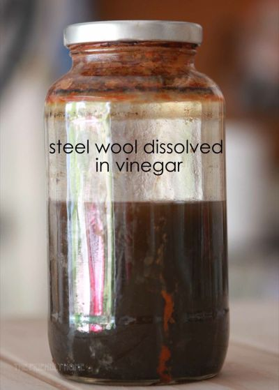 This jar of oxidizing solution is about eight weeks old. It darkens as it ages. Edited to add: your jar will not look rusty like mine until your solution has been sitting in the jar for a long time. When you first make your solution it should be a grey-ish color with some solids on the bottom and murky vinegar on top.
